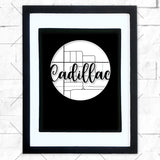 Close-up of Cadillac hometown map design in black shadowbox frame with white matte