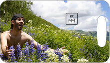 Load image into Gallery viewer, Man Embracing Wildflowers Luggage Tag