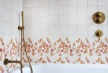 Load image into Gallery viewer, Cherry tile in Rust & Rose by Feild. Handmade and hand painted glazed terracotta tiles. Installed around a bath