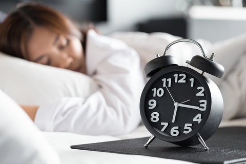 Woman Adjusting to Better Daylight Savings Sleep Schedule | Mediflow