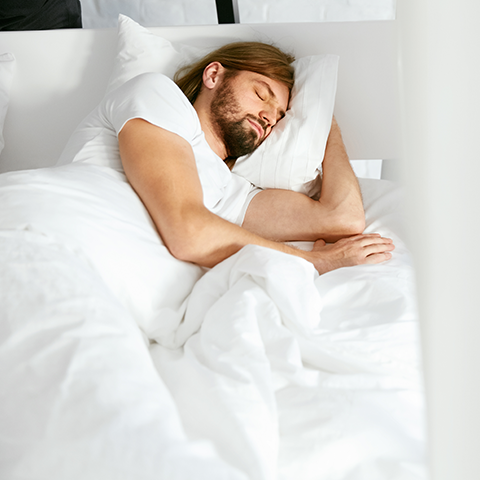 Man Receiving Benefits From Quality Sleep on Water Pillow | Mediflow