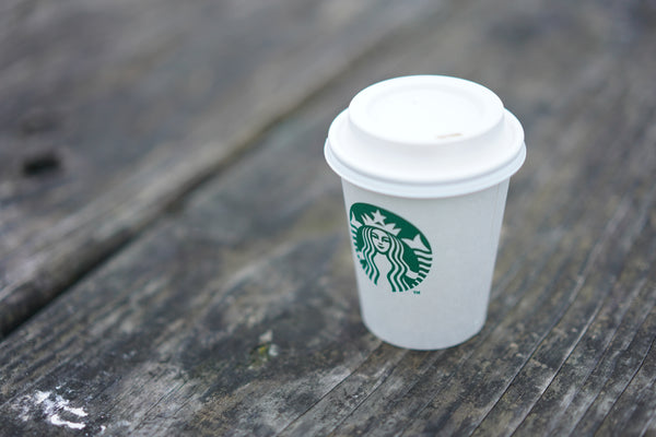 Starbucks cup on wooden plank