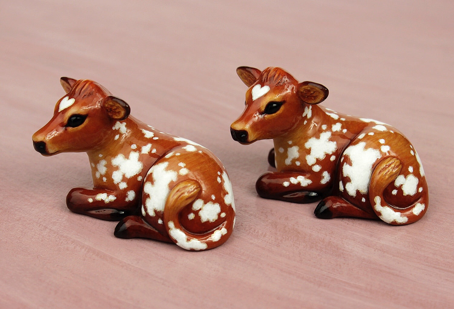 brown cow figurines