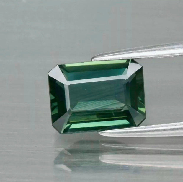 1.60 CT, Sapphire, VVS Eye Clean, Green Color, Heated Only, Octagon Cut Gemstone.