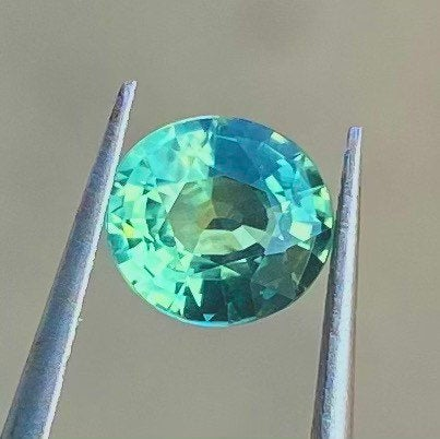 1.28 CT Certified Sapphire, Unheated, VVS Eye Clean,  Bluish Green, Oval Cut Gemstone.