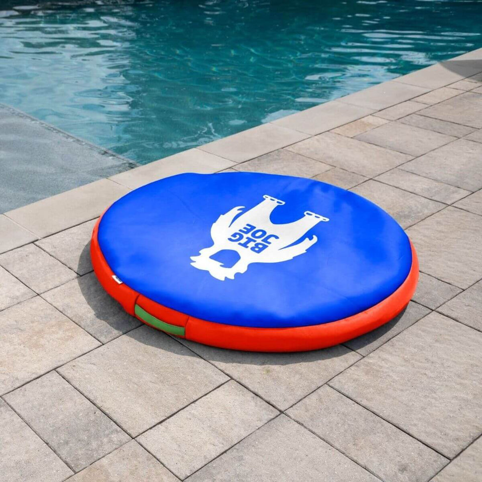 "48"" Round Pool Float with Big Joe guy print next to pool"