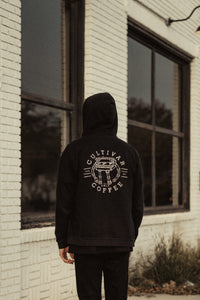 Back view of Cultivar's 2020 Black zip-up hoodie with coffee robot design across back