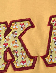 Heather Yellow Gold Crewneck With Foxes In The House On Cardinal Red Twill - JennaBenna Sorority