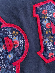 Navy Blue V-Neck With Floral Les Fleur Blue On Greek Pink Twill - JennaBenna Sorority