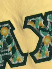 Butter Long Sleeve Crewneck With Succulents Cactus Patch On Hunter Green Twill - Sorority Apparel