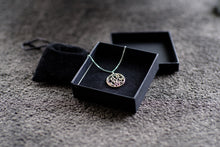 Load image into Gallery viewer, Arabic calligraphy circular pendant, sterling silver with silver chain in black box.
