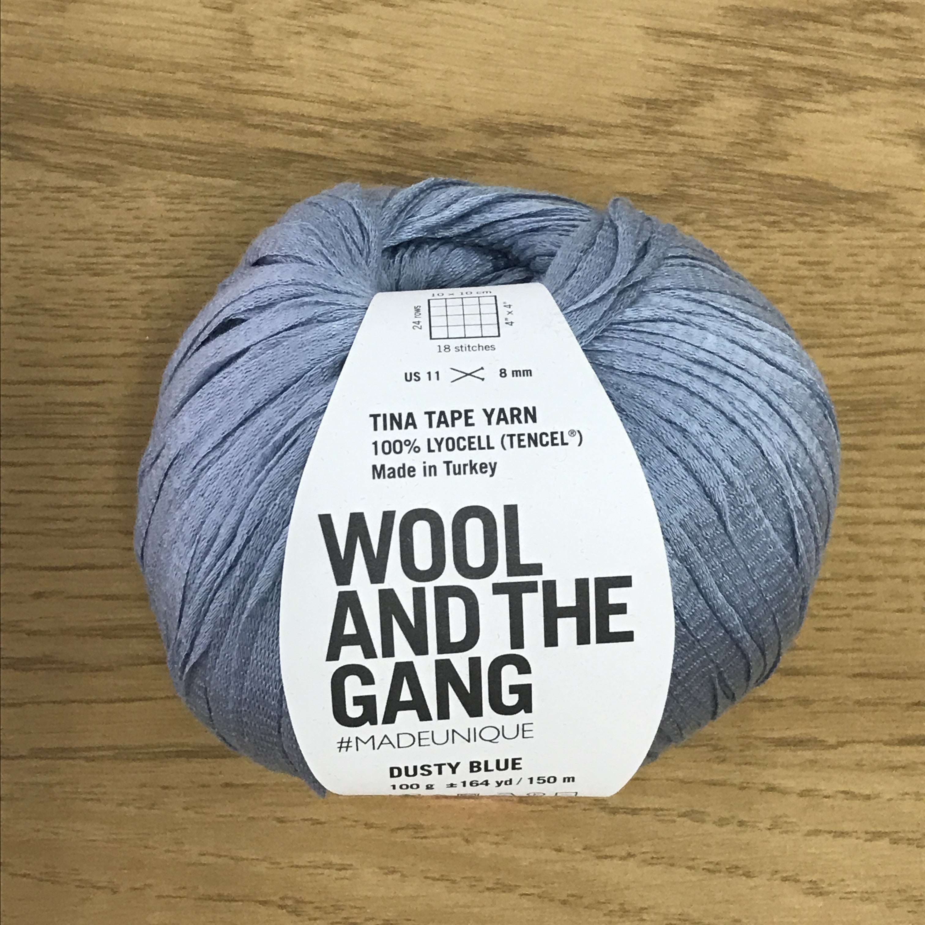 Tina Tape yarn is new from Wool and the Gang! Tencel is sourced from eucalyptus trees, vegan, and good for the environment. Softer than silk and light as air! Dusty Blue