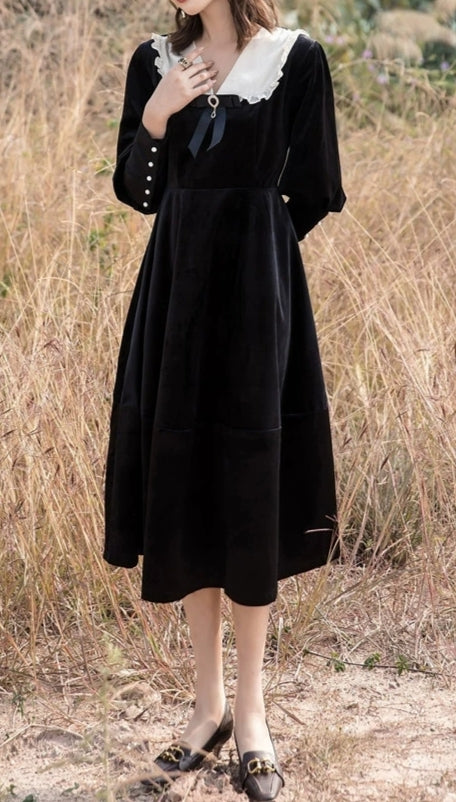 Black velvet long sleeve dress with white collar and bow