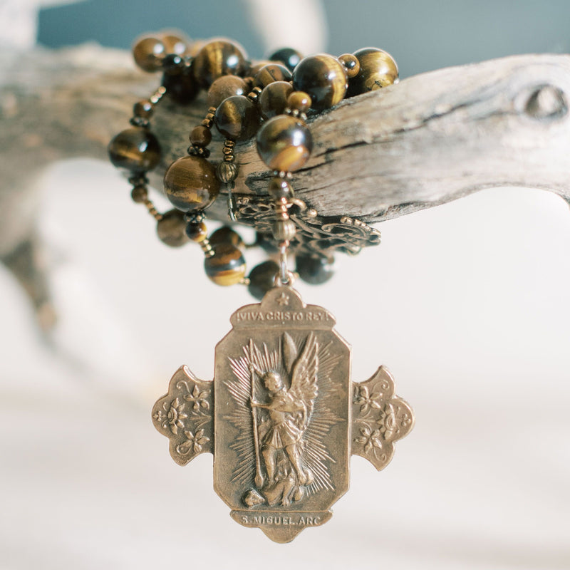Bronze St Michael medal on the end of a chaplet with tiger eye beads