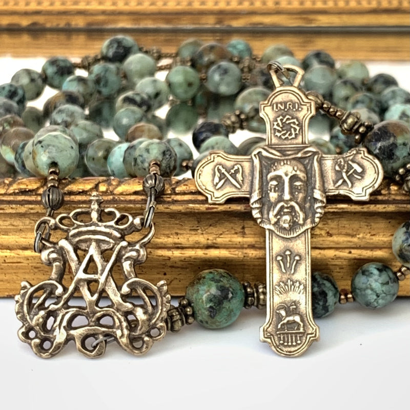 Auspice Maria center on left and Holy Face cross on the right. Ave Maria African Turquoise Rosary beads in background.