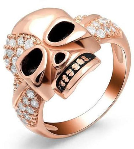 black and pink skull ring