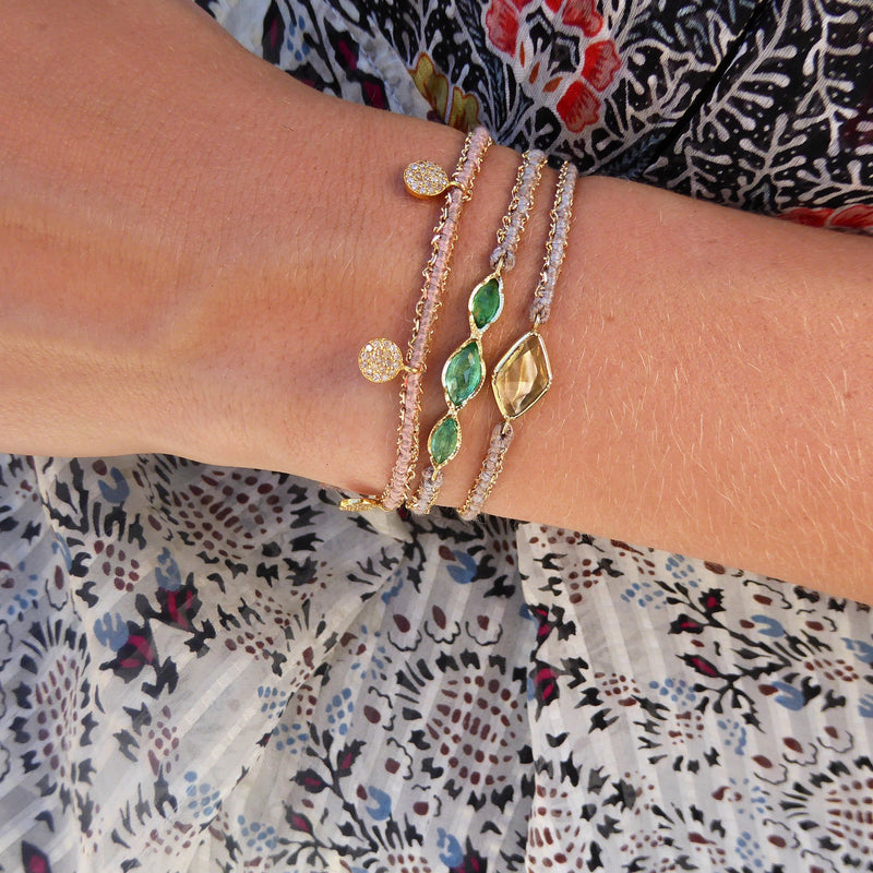 Model wearing Hand made in Los Angeles Brooke Gregson 14k gold diamond coin silk woven bracelet
