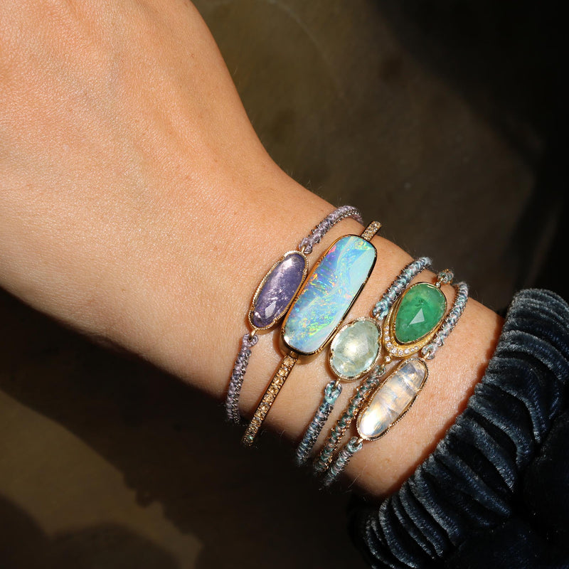 Model wearing Hand made in Los Angeles Brooke Gregson 14k gold aquamarine silk woven chain bracelet