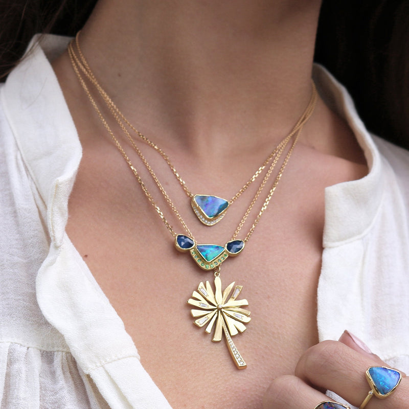 Model wearing Hand made in London Brooke Gregson 18k gold Boulder Opal Sapphire Tsavorite Necklace