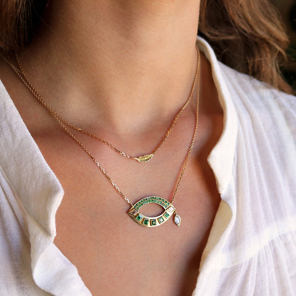 Model wearing Hand made in London Brooke Gregson 18k gold Emerald Diamond Eye Necklace