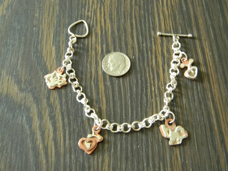 Sterling Silver Bracelet with Copper and Silver Charms by Athena Silversmith Handcrafted Price $110