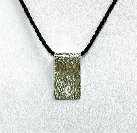 Luna Scroll Necklace by Yleana Martinez Silver pendant on a twiested polyester cord Price $29on a