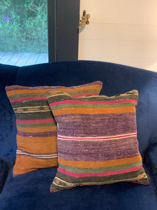 Purple and orange striped pillow