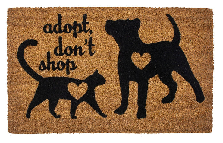 "A coir doormat with black dog and cat sihouettes with ""Adopt Don't Shop"" text."