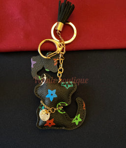 red purple and green spotted cat shaped keychain with Checkerboard pattern