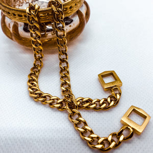 gold link chain bracelet with small enraged 'good luck'