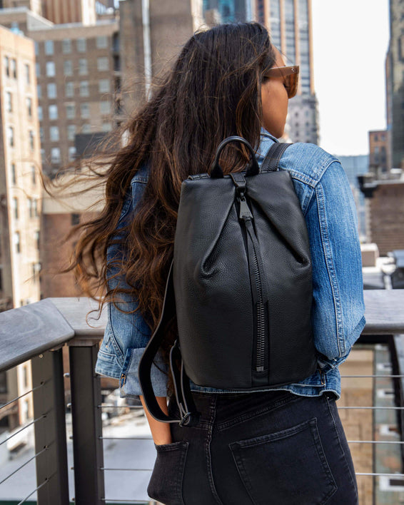Tamitha Backpack - black with shiny black hardware on model