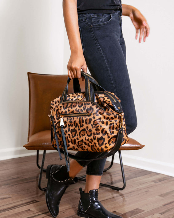Night Is Young Satchel - large leopard haircalf on model
