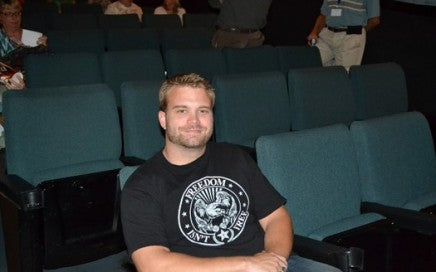 Josh Miller about to watch his film in a theatre.
