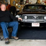 ray in garage with mustang