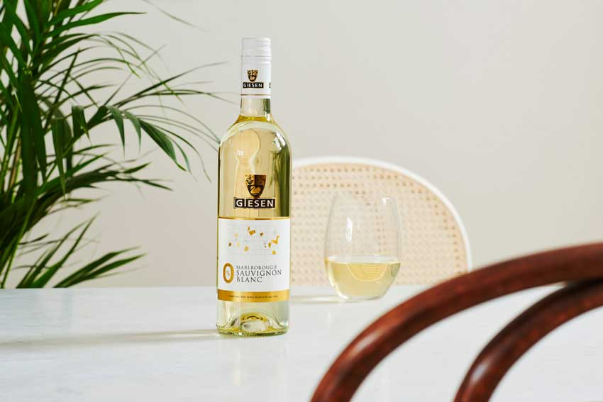 Bottle and glass of Giesen 0 wine on a table
