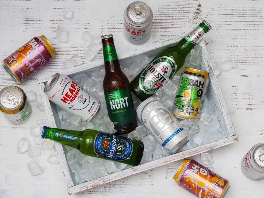Non-alcoholic beer bottles and cans on ice