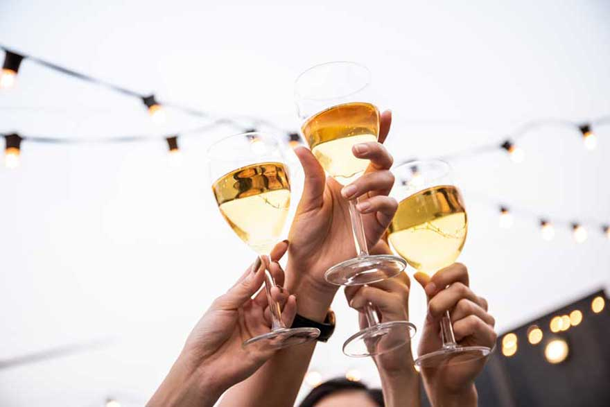 Toasting alcohol-free Chardonnay in the sun