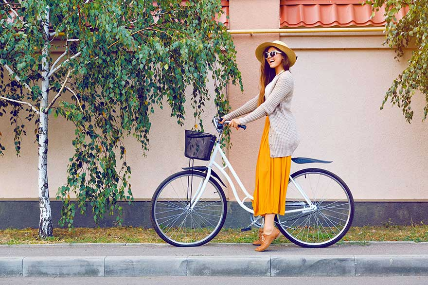 Young woman with her push bike