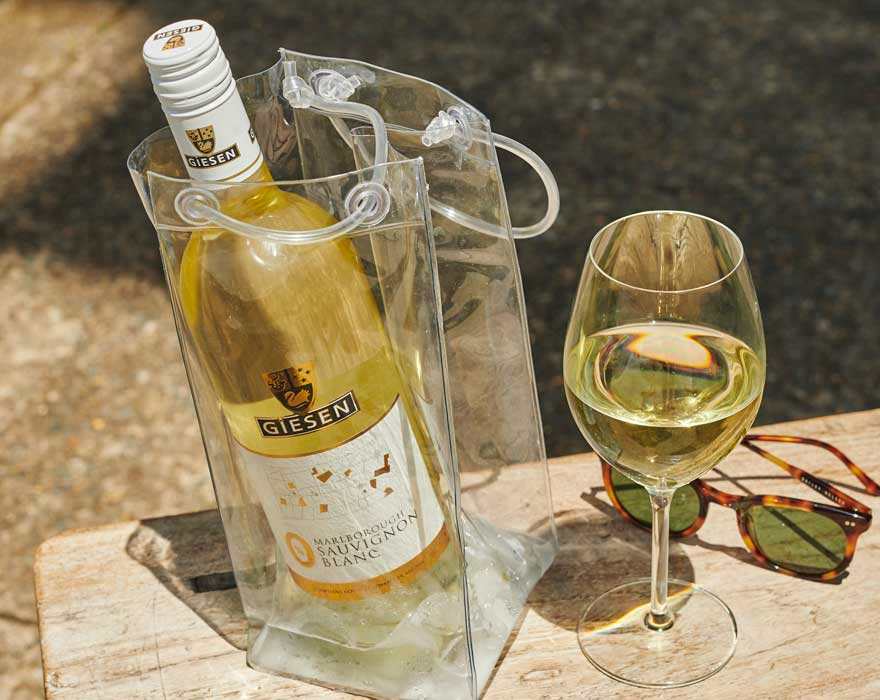 Bottle of Giesen 0 Wine in bag with sunglasses