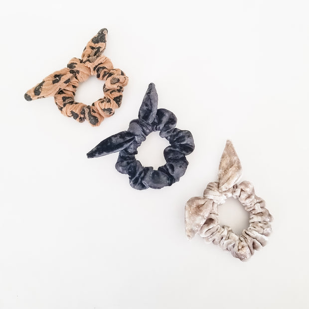 Three mini scrunchies in velvet and animal print