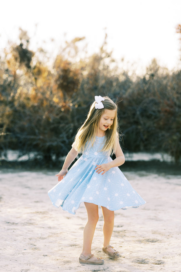 Little girls twirl dress in light blue