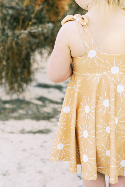 Modern toddler twirl dress in mustard