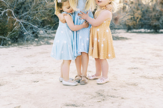 Sunshine twirl dresses in mint, light blue and mustard