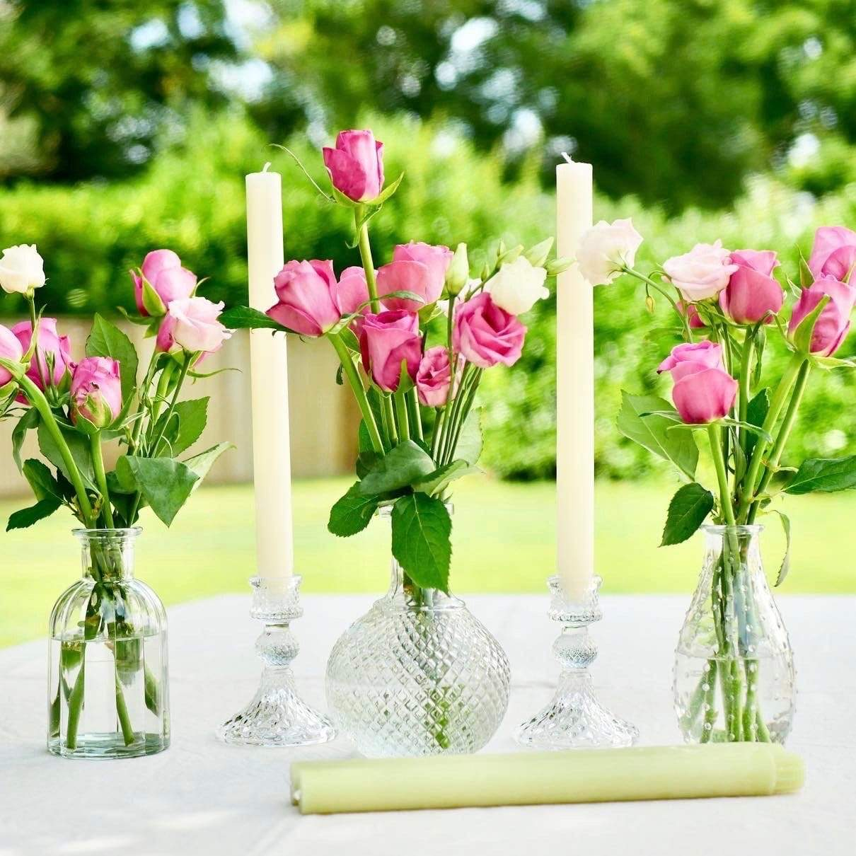 cut glass candlesticks and coloured candles