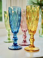 Load image into Gallery viewer, Coloured champagne glasses in pink, blue, yellow and green.