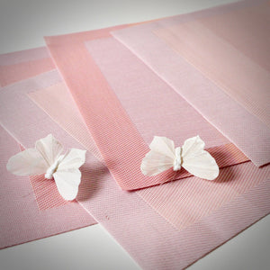 pink placemats with ivory butterflies