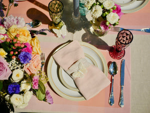 Place setting, summery tablescape. Blush linen napkin, lace tie.
