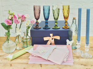 Treat Yourself Tablescape comes with three bud vases, four coloured candles, four linen napkins, four pink placemats, two glass candlesticks, four coloured champagne glasses, a fish bottle and six ivory butterflies for decoration. Gorgeous!