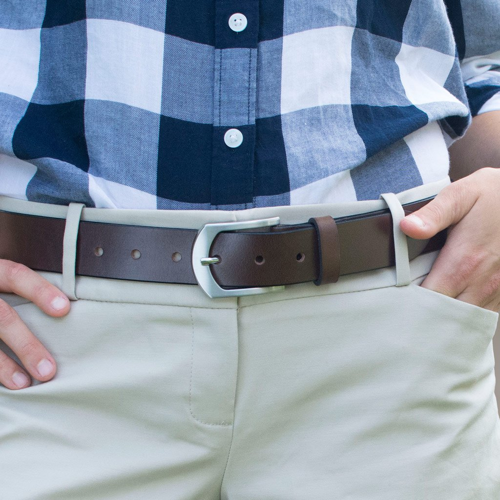 Picture of the Stone Mountain Brown Leather Belt on a female model wearing khaki pants.  Brown Leather strap with nickel free silver arched buckle.  Hypoallergenic.