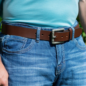 Pathfinder Belt by Nickel Zero - nickelfreebelts.com, man wearing a brown full grain leather belt with a silver rustic buckle made in the USA